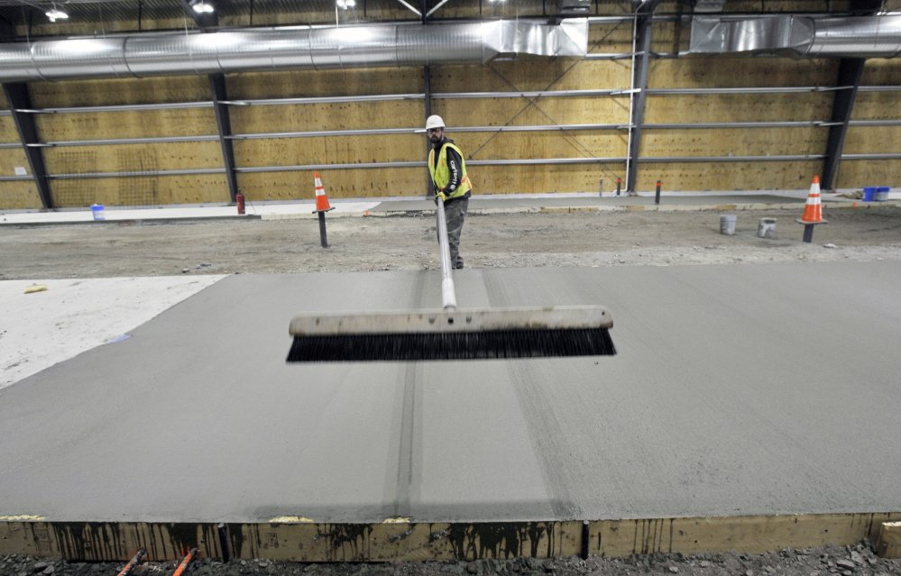 Justin Woodcock of Concrete Craftsmen, based in North Monmouth, works on the Downeaster layover station. Maine had 3,389 specialty contractors in 2015, down 34 percent from 5,171 in 2001, according to state data.