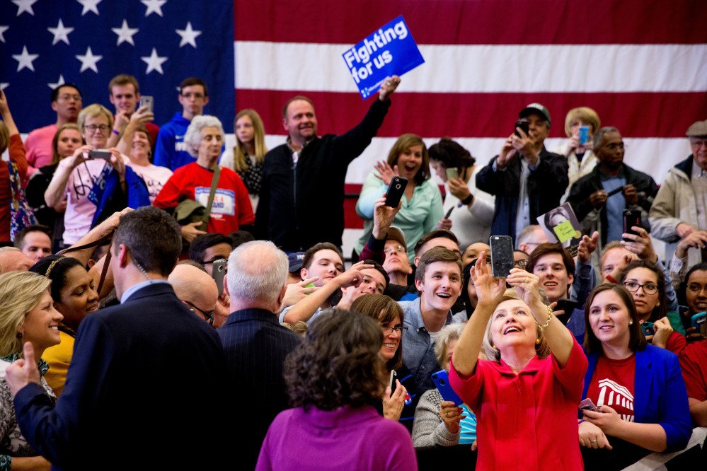 Democratic presidential candidate Hillary Clinton takes a group selfie after speaking at a get-out-the-vote event at Transylvania University in Lexington, Ky., on Monday.