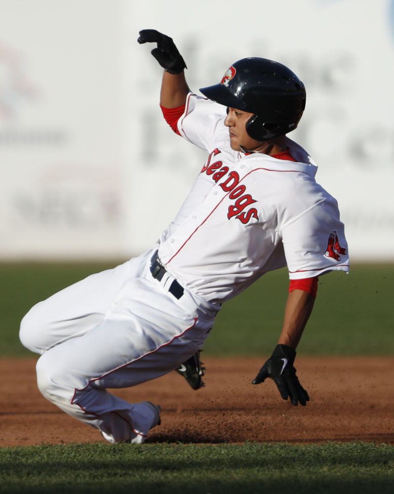 PORTLAND, ME Ð MAY 17: Portland Sea Dog's Tzu-Wei Lin slides into second during the third inning of their game Tuesday, May 17, 2016 against the New Hampshire Fisher Cats at Hadlock Field in Portland, Maine. (Photo by Joel Page/Staff Photographer)