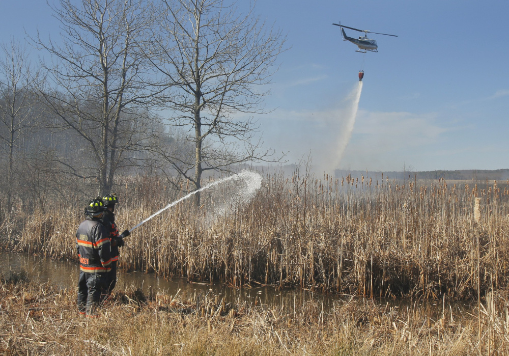 A seven-alarm brush fire that burned 42 acres of Old Orchard Beach marshland and forced the evacuation of a condominium complex was allegedly set by Fire Chief Ricky Plummer, who retired this week.