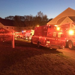Firefighters respond to a fire early Saturday at the Oxford Meadow Apartments complex in Oxford. One woman was killed in the fire and another is in critical condition.
