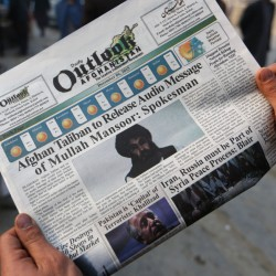 A newspaper last December shows photos of the leader of the Afghan Taliban, Mullah Mansour. A U.S. official says unmanned aircraft carried out an attack on him Saturday.