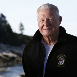 Capt. Earl Walker poses in Southport,. He held off retirement until he had the opportunity to pilot the Navy's futuristic Zumwalt destroyer safely down the Kennebec River to the Atlantic Ocean for sea trials earlier this year.