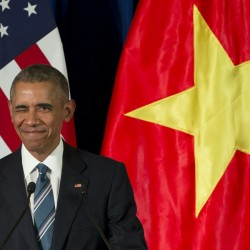President Barack Obama winks as he arrives for a news conference with Vietnamese President Tran Dai Quang Monday at the International Convention Center in Hanoi, Vietnam.