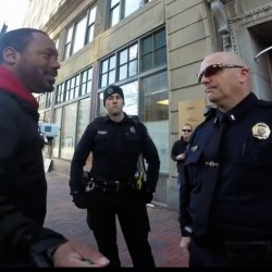 Pastor Andrew March talks with Portland police outside Planned Parenthood offices last fall. He later sued, arguing he was targeted because of his anti-abortion message.