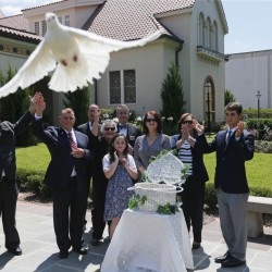 The family of Army Pvt. Earl Joseph Keating releases a dove after his remains arrived at the Schoen Funeral Home in New Orleans on Monday. Keating's remains were discovered on the island of New Guinea where he died in 1942.