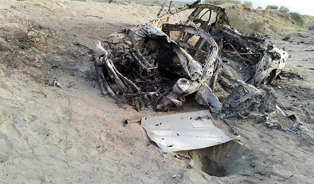 This photo purports to show the destroyed vehicle in which Mullah Mohammad Akhtar Mansour was traveling in the Ahmad Wal area in Baluchistan province of Pakistan, near Afghanistan's border, when he was believed to have been killed in a drone strike.