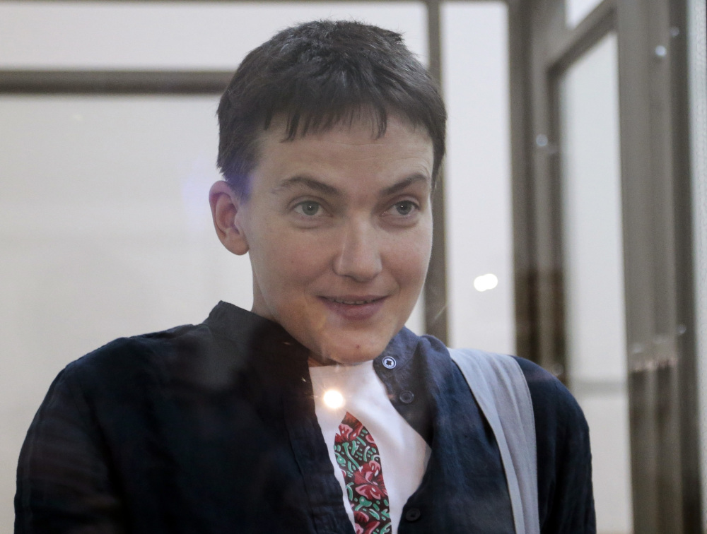 Nadezhda Savchenko smiles at journalists from a glass cage in court, in Donetsk, Rostov-on-Don region. Russian President Vladimir Putin announced Wednesday that he will pardon the Ukrainian pilot.