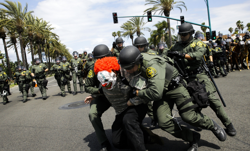 Orange County, California, sheriff's deputies take a protester into custody outside the convention center where presidential candidate Donald Trump held a rally Wednesday.