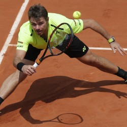 Stan Wawrinka of Switzerland returns the ball to  Taro Daniel of Japan during their second-round match at the French Open on Wednesday in Paris. The reigning champ, Wawrinka won, 7-6 (9-7), 6-3, 6-4.