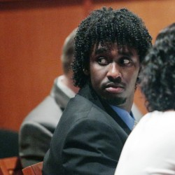 Abdirahman Haji-Hassan, 25, who is charged in the 2014 shooting of Richard Lobor in Portland, appears with his attorney for a pretrial hearing Thursday in the Cumberland County Courthouse.