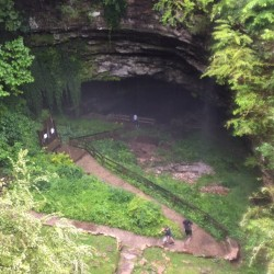 People leave the Hidden River Cave in Kentucky on Thursday after officials said a group exploring the cave got trapped by rising water caused by heavy rains.