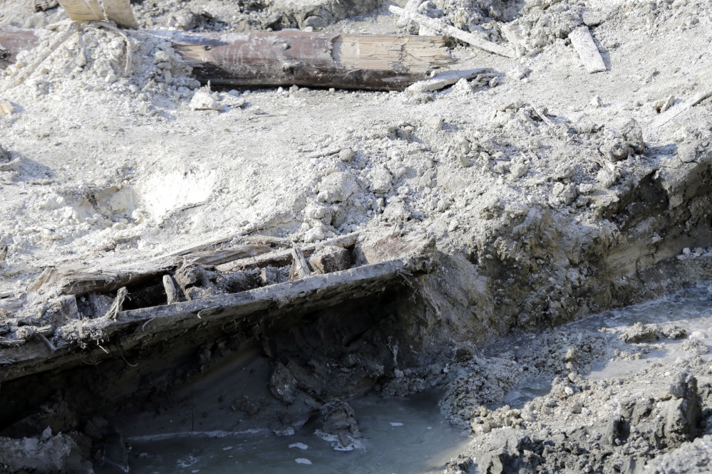 A portion of a shipwreck from the 1800s that has been uncovered during construction in the Seaport District is seen Wednesday in Boston.