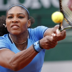 Serena Williams returns the ball to Brazil's Teliana Pereira during their second round match of the French Open tennis tournament at the Roland Garros stadium on Thursday. Williams won the match in straight sets.