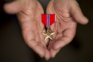 Dennis Andrews displays his Bronze Star after receiving it at a ceremony attended by hundreds Saturday.