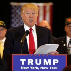 Republican presidential candidate Donald Trump reads from a list of donations to veteran's groups, during a news conference in New York Tuesday.
