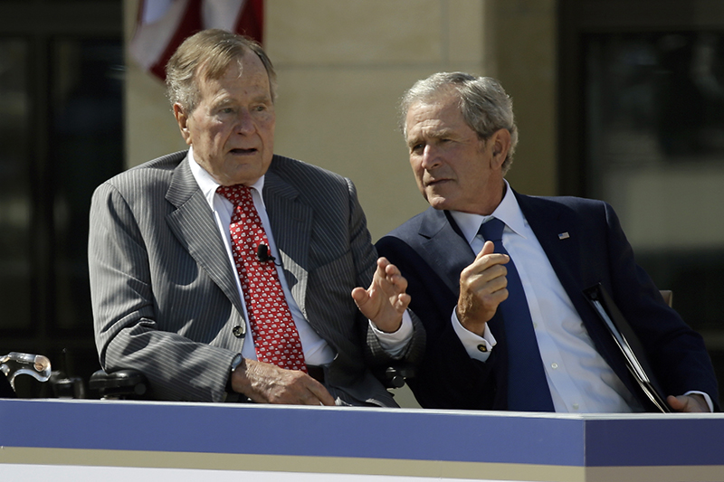 Former President George W. Bush, right, and his father, former President George H.W. Bush, have no plans to endorse Donald Trump.