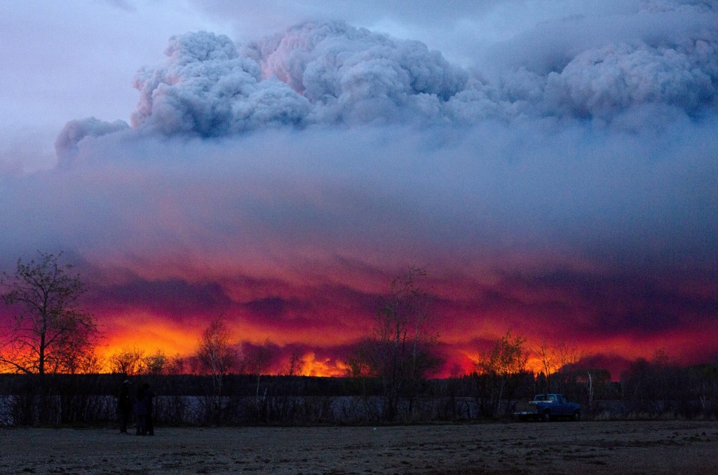 A wildfire moves toward the town of Anzac from Fort McMurray, Alberta., on Wednesday. Unseasonably hot temperatures combined with dry conditions have transformed the boreal forest in much of Alberta into a tinder box.