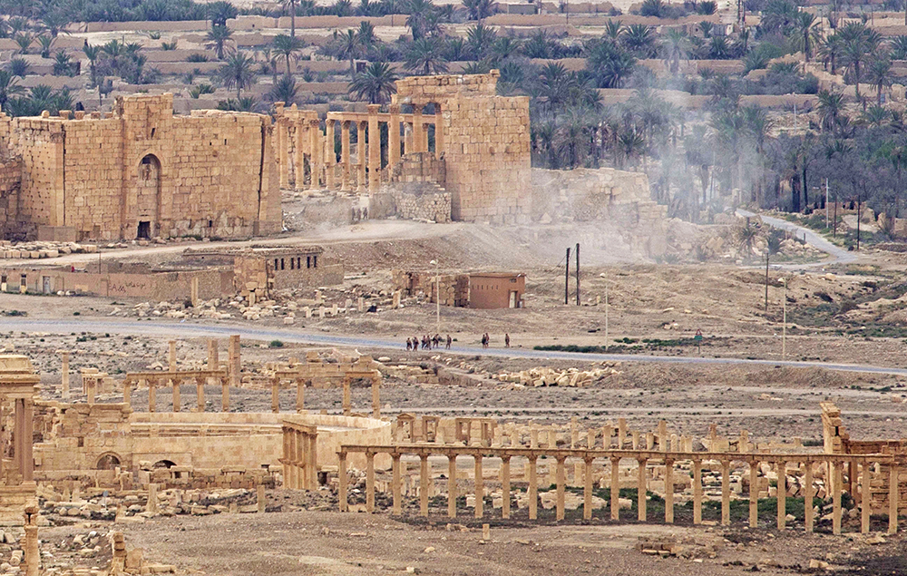 Russian soldiers conduct a controlled land mine detonation in the ancient town of Palmyra in this April 14, 2016, photo. Syrian troops, with the help of Russian airstrikes, regained control of the world-famous ancient city in March after the Islamic State had controlled it for nearly 10 months. The Associated Press