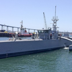 A self-driving, 132-foot military ship sits at a maritime terminal Monday, May 2, 2016, in San Diego. The Pentagon's research arm is launching tests on the world's largest unmanned surface vessel designed to travel thousands of miles out at sea without a single crew member on board.