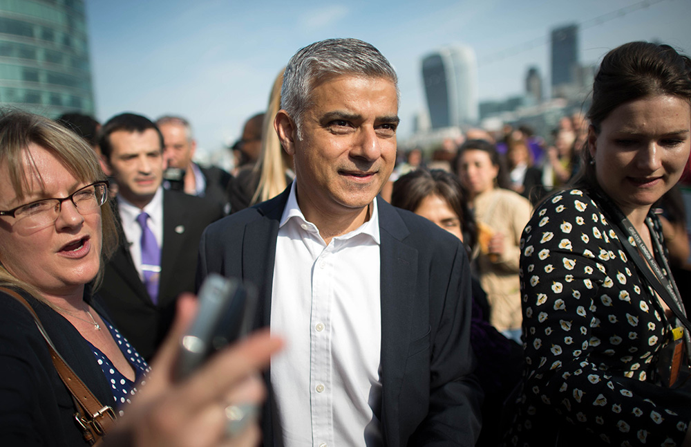 Newly elected London Mayor Sadiq Khan is greeted by well wishers outside City Hall in London, on his first day as mayor on Monday. Jonathan Brady/PA via AP