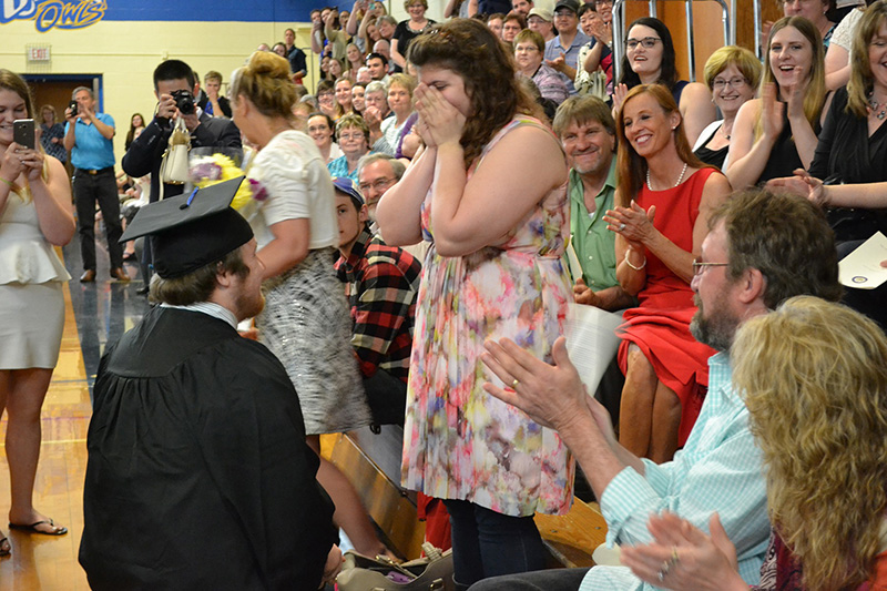 Timothy Babine proposes to his girlfriend, Hayley Hamilton, during commencement exercises at the  University of Maine at Presque Isle.
