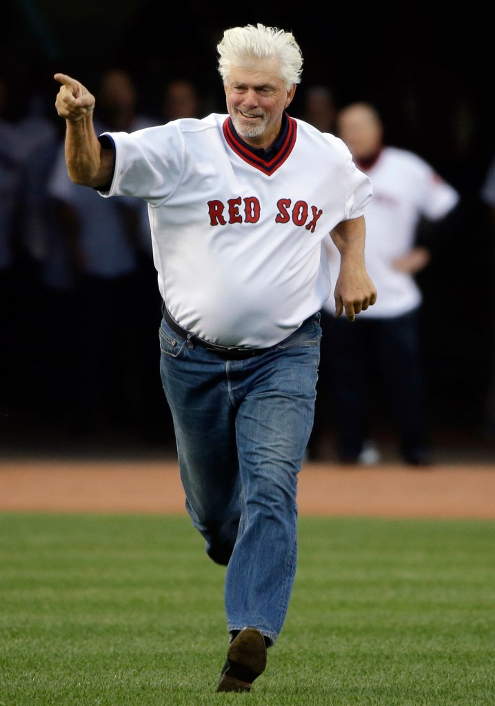 "Former Red Sox pitcher Bill ""Spaceman"" Lee runs onto the field to join former teammates during pre-game ceremonies at Fenway Park in 2015. Lee is running for governor in Vermont as a member of the Liberty Union party."