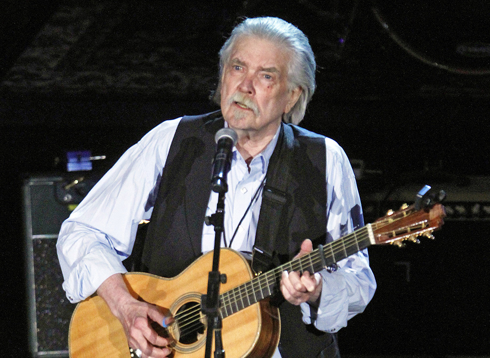 """Guy Clark performs at the 11th Americana Honors & Awards in Nashville, Tenn., in this Sept. 12, 2012, photo. Born in 1941, Clark's upbringing in west Texas inspired the scenes and characters for many of his songs, including """"Desperados."""" Wade Payne/Invision/AP"""