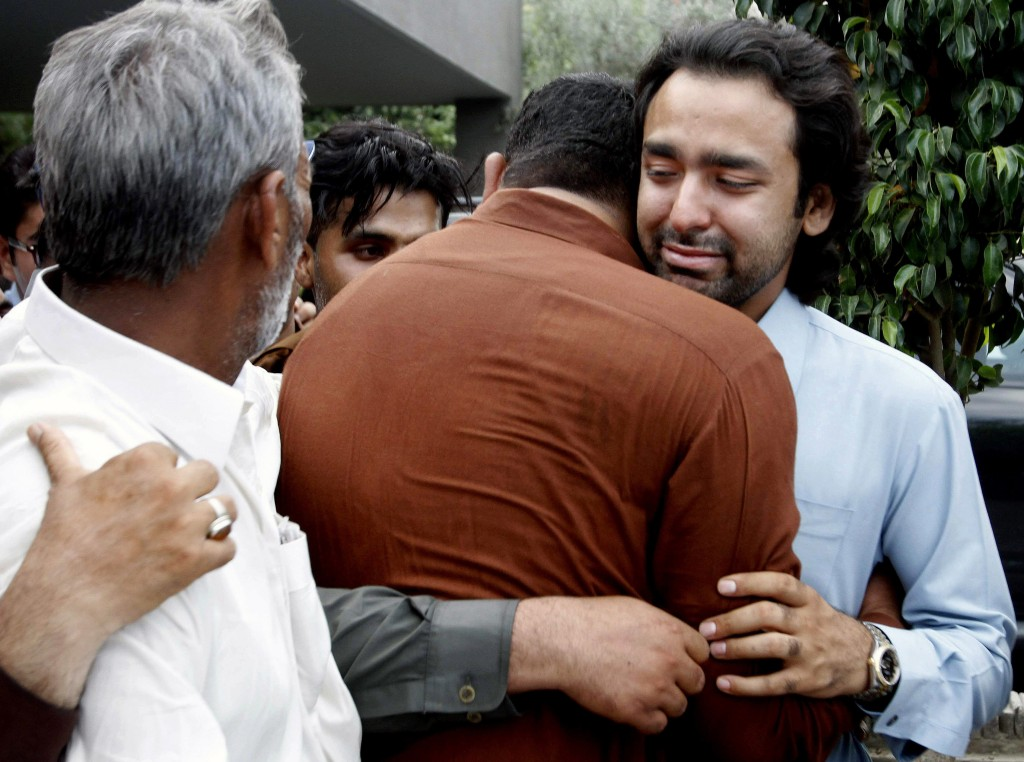 In this May 2013 photo, people comfort Musa Gilani, right, the brother of Ali Haider Gilani who was kidnapped in Multan, Pakistan. Ali Haider Gilani was rescued Tuesday after three years of captivity in a joint raid by U.S. and Afghan forces. The Associated Press