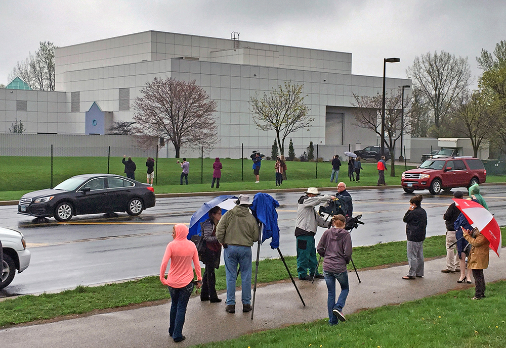 People stand outside  Prince's Paisley Park compound in Chanhassen, Minn., In this photo taken on April 21, 2016, the day the pop singer was found dead in an elevator there. Jim Gehrz/Star Tribune via AP