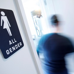 """A bathroom sign welcomes both genders at the Cacao Cinnamon coffee shop in Durham, North Carolina. The shop installed the signs after North Carolina's """"bathroom law"""" gained national attention, positioning the state at the center of a debate over equality, privacy and religious freedom.  — Reuters"""
