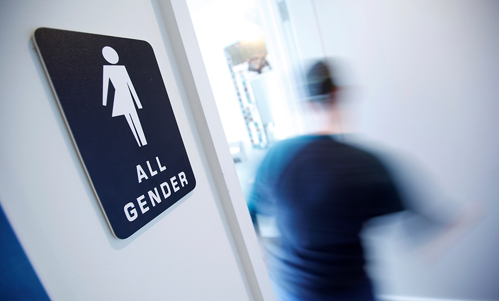 "A bathroom sign welcomes both genders at the Cacao Cinnamon coffee shop in Durham, North Carolina. The shop installed the signs after North Carolina's ""bathroom law"" gained national attention, positioning the state at the center of a debate over equality, privacy and religious freedom.  — Reuters"