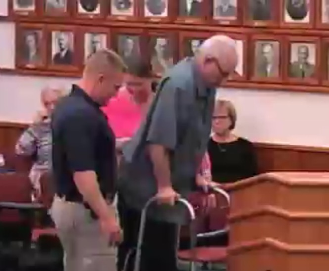 For the first time since a 2014 motorcycle crash left  Augusta police chief paralyzed, Robert Gregoire walks to the podium at a council meeting.