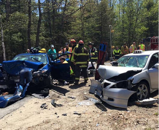 Rescuers respond to a two-vehicle crash that injured four people in New Gloucester Saturday. Photo courtesy WCSH TV