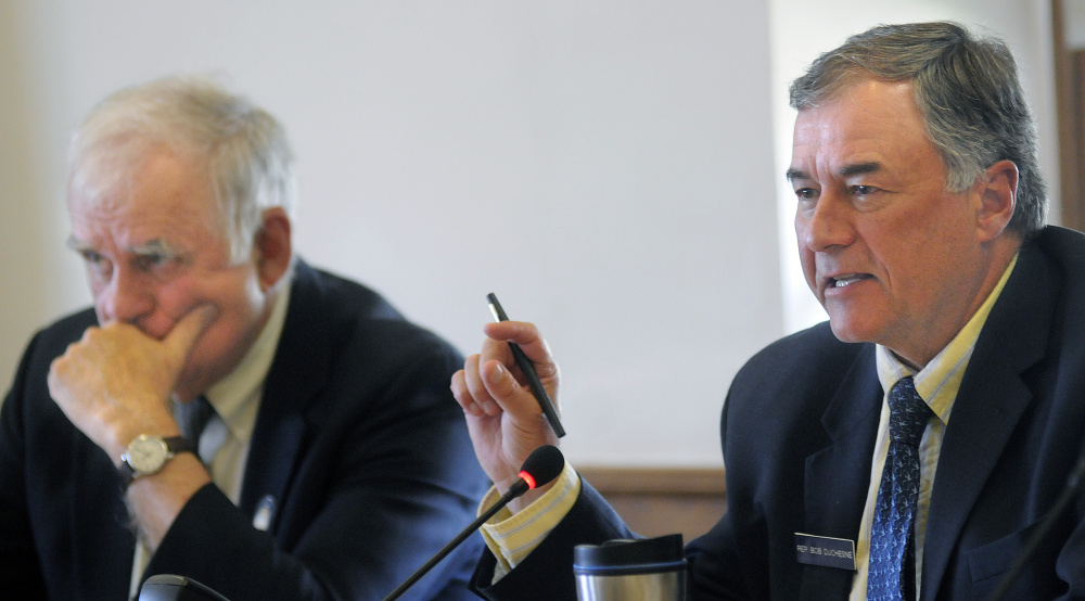 Rep. Robert S. Duchesne, D-Hudson, right, and Senator Paul Davis, R-Sangerville, members of the Inland Fisheries and Wildlife Committee, are seen at a legislative hearing in Augusta on Wednesday over a Maine Sunday Telegram story about an undercover game warden operation.