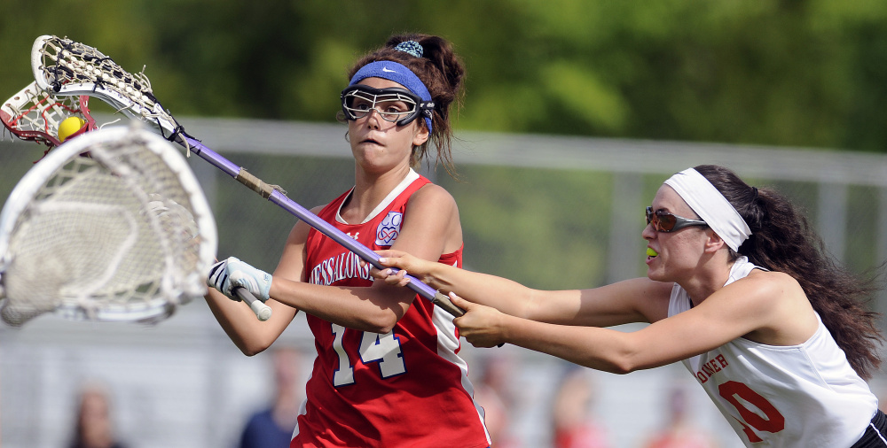 Gardiner's Bryce Smith, right, blocks Messalonskee's India Languet during a lacrosse game Wednesday in Gardiner.