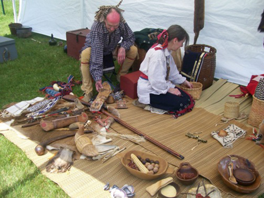 Jeff and Gail Usher prepare their Native American display at the Chapman-Hall House for the Three Traditions program.