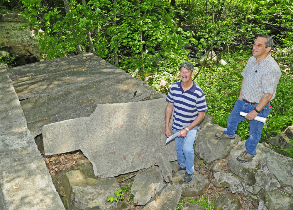 Bob Harris, left, and Jerry Bley stand on top of the washed out dam on Thursday on the Mill Stream in Readfield. They're part of a group planning to renovate the area by adding trails and other improvements aimed at providing greater public access.