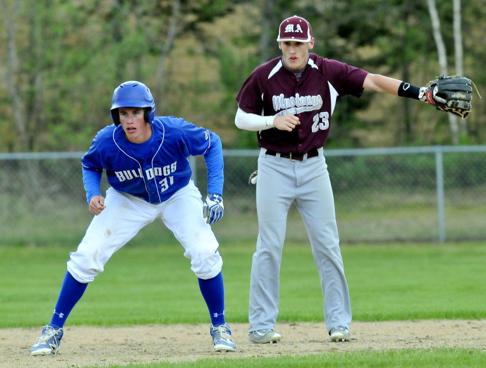 Monmouth shortstop Hunter Richardson, right, calls for a pickoff attempt at second base as Madison runner gets his lead during a game last month. The Mustangs (16-0) enter the Class C South playoffs as the No. 1 seed. The Bulldogs (14-2) are the No. 3 seed.