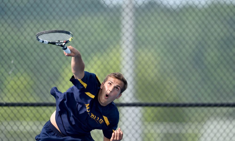 Staff photo by Michael G. Seamans Mt. Blue High School's Alex Bunnell competes against Mt. Ararat High School's Joey Reed in Farmington on Thursday. Bunnell won the match, 6-0, 6-1.