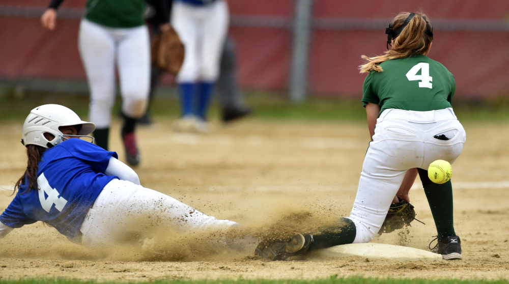Messalonskee baserunner Kelsey Dillon (4) slides safely into second base as Oxford Hills' Kaisa Heykkenen tries to handle the ball during the Kennebec Valley Athletic Conference Class A championship game Friday.