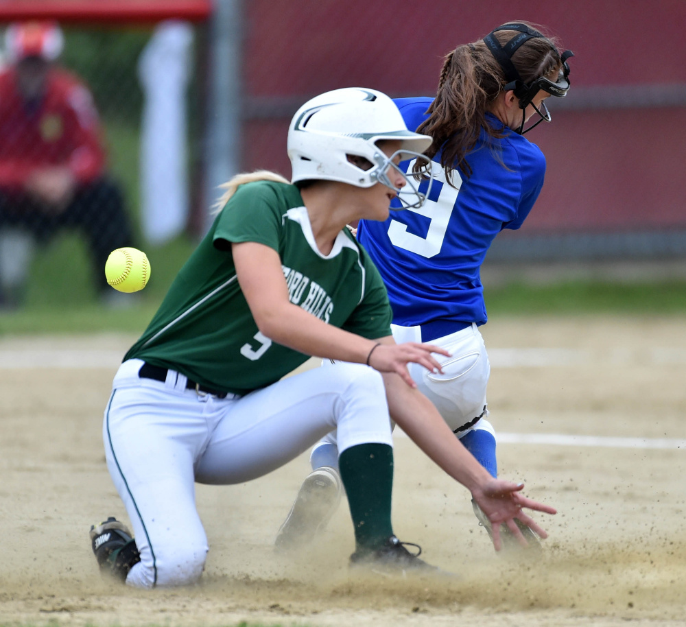 Oxford Hills' Madison Starboard slides safely into second base as Messalonskee's Madisyn Charest tries to handle the ball during the Kennebec Valley Athletic Conference Class A championship game Friday.