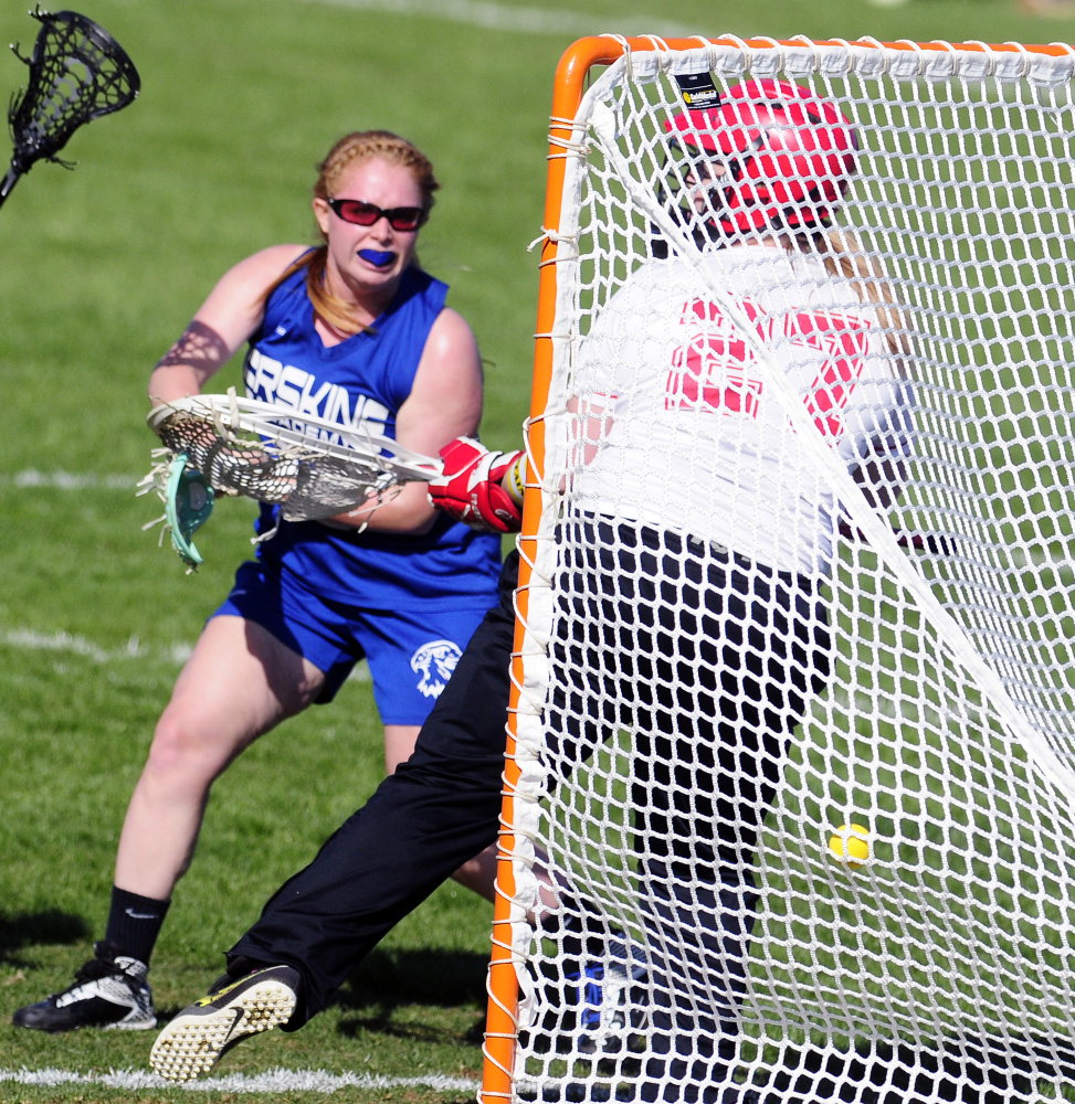 Erskine senior midfielder Kaitlyn Darveau\ shoots and scores on Cony keeper Lizzie Dennison during a Class B North game last month. The Eagles enter the Class B North playoffs as the No. 7 seed.