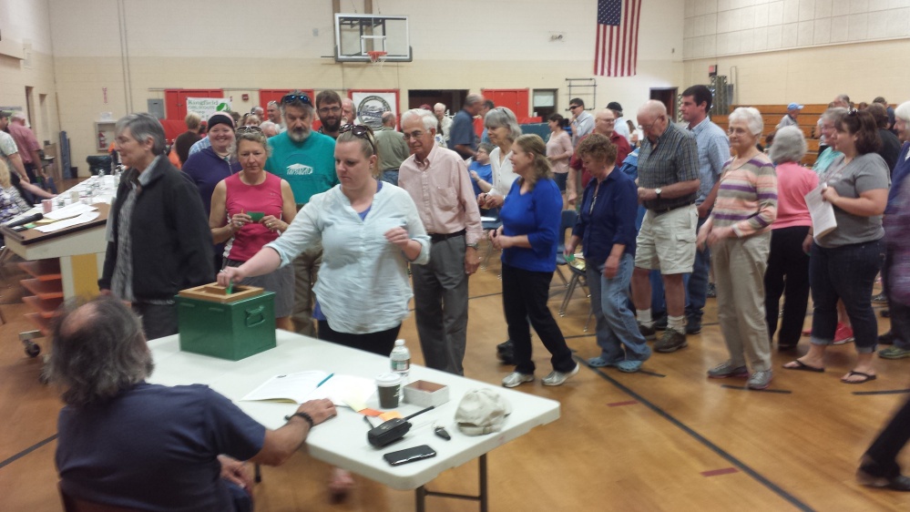 Kingfield residents vote by secret ballot Saturday in the election of municipal officials at Kingfield Elementary School.