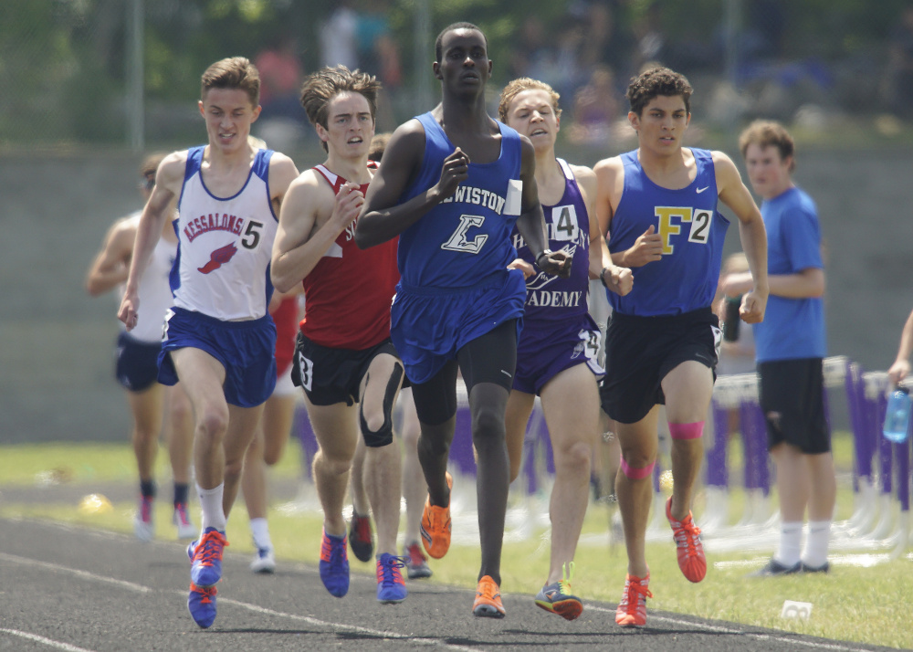 Lewiston senior Osman Doorow leads a tight pack in the final lap of the 1,60-meter run Saturday at the Class A state track and field championships at Hampden. Messalonskee junior Owen Concaugh, left, finished fourth, but not all was lost for him Saturday. Concaugh helped the 4x800 relay team to victory and also won the 800.