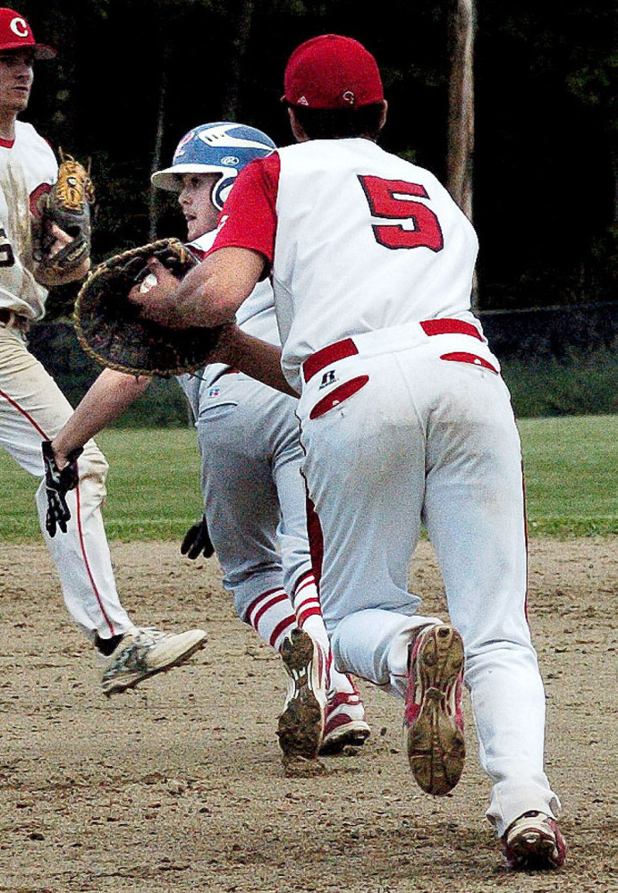 Messalonskee's Jonathan Wilkie is run down by Cony's Anthony Brunelle on Monday in Oakland.