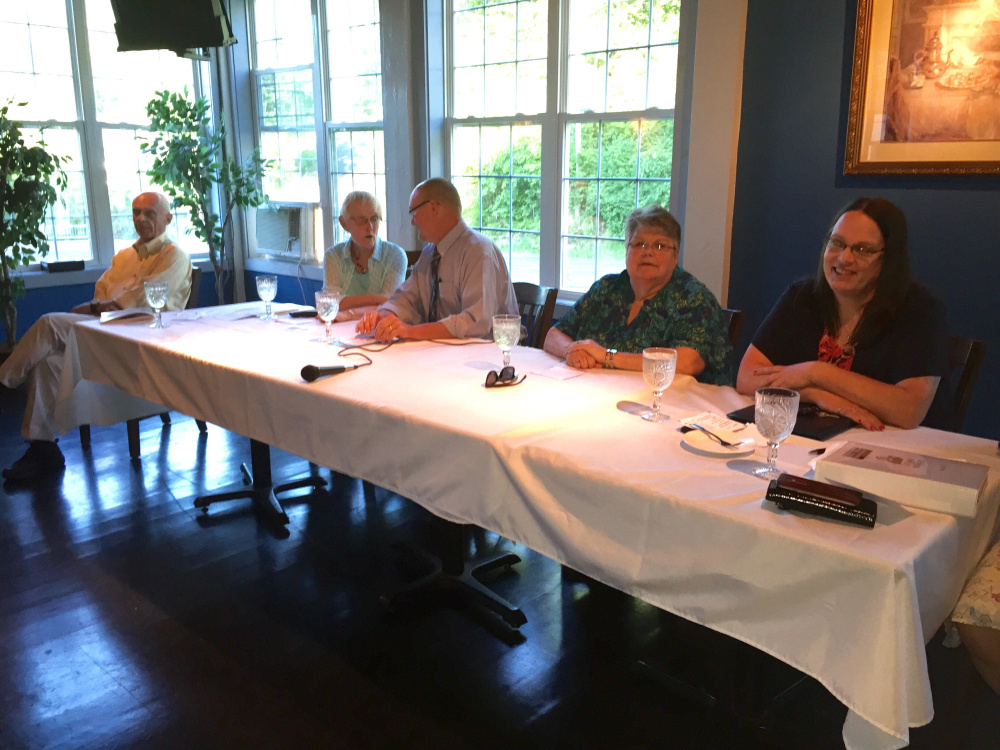 Wilton Selectboard candidates, from left, Tiffany Maiuri, Ruth Cushman, David Leavitt, Betty Shibles and Irving Faunce partake in a meet and greet event Monday night.