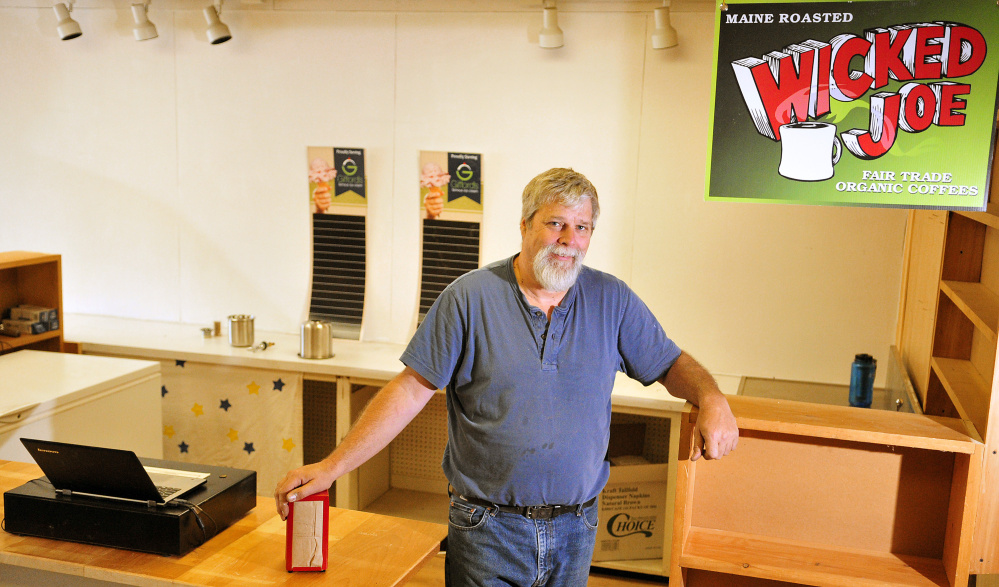 David Brown stands behind the counter last week at Coffee & Cones, which is in the former Apple Valley Books store on Main Street in Winthrop.