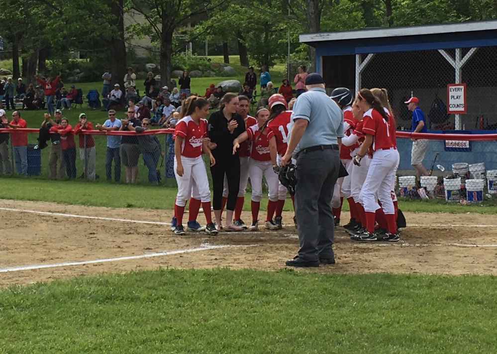 Members of the Messalonskee softball team greet Katie Guarino at home plate after she belted a home run in the bottom of the fifth inning of a Class A North quarterfinal game against Mt. Ararat. The homer stood as the only run of the game.