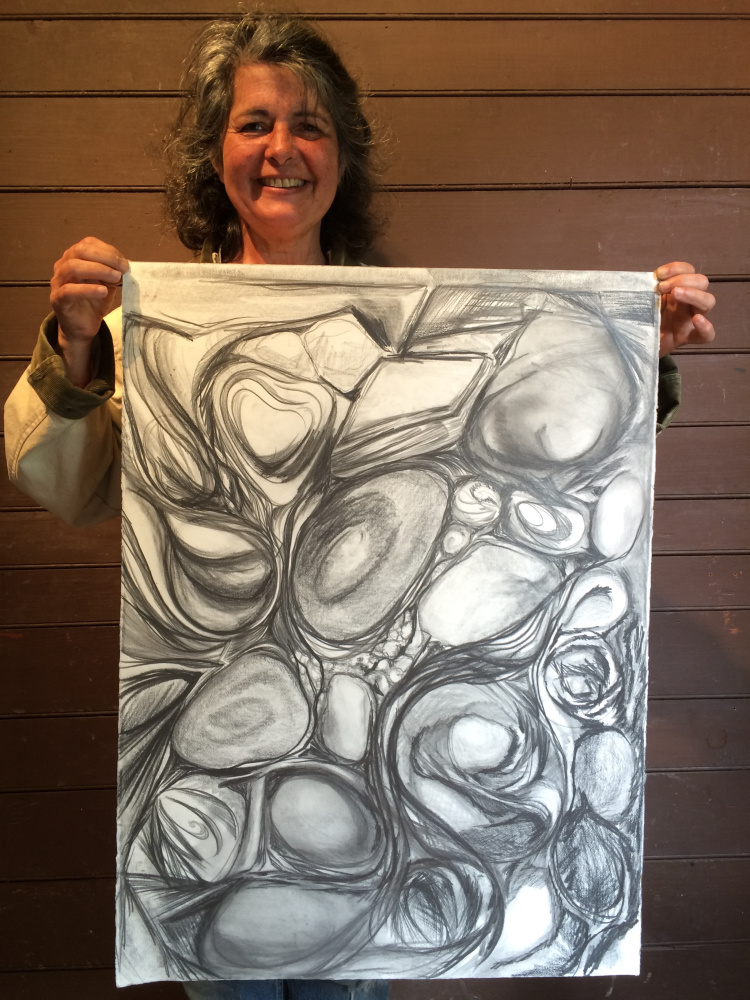 """Roz Welsh, artist member of Stable Gallery with her drawing from """"The Drawing Room."""""""